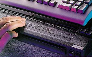 A person useing a Refreshable braille display