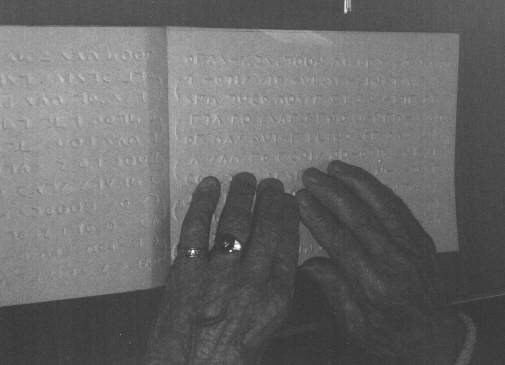 This is where their is a image of a person reading moon, the moon book  is laid out in front of the person and he/she is reading it with their fingers as we do with our Braille books and magazines, this is how it has been described to me I hope that you will forgive me for this explanation